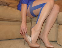 Women`s legs in sheer pantyhose and High Heels Stock Image