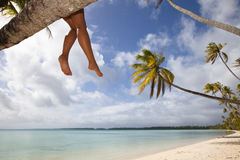 Women's legs on white sand beach Royalty Free Stock Photos