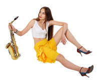 Women's long sitting with sax Stock Images