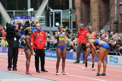 Womens 100m Great City Games Manchester 2015. The sprinters waiting for their times to come through. Pictured are Jessica Young (who won), English Gardner Stock Photography