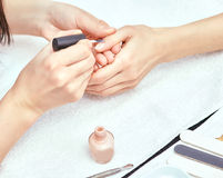 Women's manicure, nail file, hand care Stock Photography