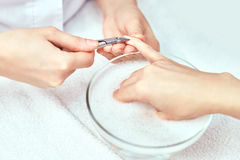 Women's manicure, nail file, hand care Stock Photos