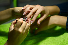 Women's manicure procedure Stock Images
