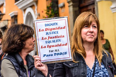 Women`s March, Antigua, Guatemala. Antigua, Guatemala - January 21, 2017: Woman holds sign in peaceful Women`s March as part of global protest protecting women`s royalty free stock photo