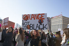 Women`s March on Chicago 2017. Chicago, IL, 01/21/2017  Woman holding `Orange is Not the New Black` sign at the Women`s March on Chicago 2017 Stock Photography