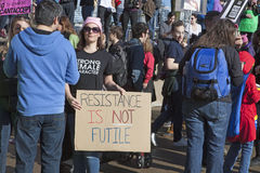 Women`s March on Chicago 2017. Chicago, IL, 01/21/2017  Woman holding `Resistance is Not Futile` sign at the Women`s March on Chicago 2017 Stock Photography