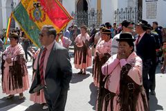 Women`s march, Sucre Bolivia - August 6, 2016: crowds march at Independance Day on the streets of Sucre in support of stock photography