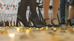 Women`s and men feet in moving indoors. Close-up stock video footage