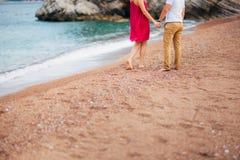 Women`s and men`s feet in the sand. Wedding in Montenegro Stock Photo