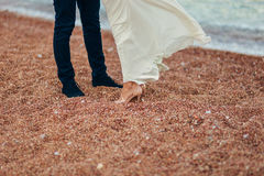Women`s and men`s feet in the sand. Wedding in Montenegro Stock Image