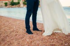 Women`s and men`s feet in the sand. Wedding in Montenegro Stock Images