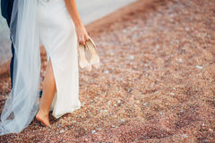Women`s and men`s feet in the sand. Wedding in Montenegro Stock Photo