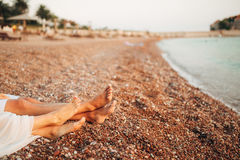 Women`s and men`s feet in the sand. Wedding in Montenegro Royalty Free Stock Image
