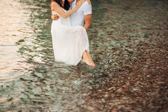 Women`s and men`s feet in the sand. Wedding in Montenegro Stock Images
