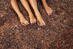 Women`s and men`s feet in the sand. Wedding in Montenegro Stock Photography