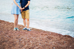 Women`s and men`s feet in the sand. Wedding in Montenegro Royalty Free Stock Photos