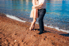 Women`s and men`s feet in the sand. Wedding in Montenegro Royalty Free Stock Images