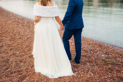 Women`s and men`s feet in the sand. Wedding in Montenegro Royalty Free Stock Photography
