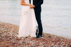 Women`s and men`s feet in the sand. Wedding in Montenegro Royalty Free Stock Photo