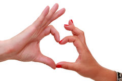 Women's and men's hands gesturing heart sign Royalty Free Stock Photography