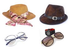 Women's and men's hats and Brown sunglasses on wihte Royalty Free Stock Images
