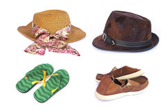 Women's and men's hats ,slippers and old red sneakers on wihte Royalty Free Stock Image