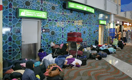Women's mosque in Dubai Airport. Oriental flight passengers waiting for their next connecting flight and sleeping in front of the women's mosque in Dubai Airport Stock Images