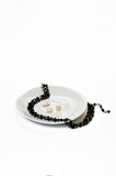 Women's necklace of black stones Royalty Free Stock Photos