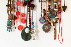 Different necklaces hanging on the wall royalty free stock images