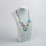 Women's necklace over grey Stock Photos