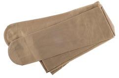Women's nylon pantyhose body color isolated on white Royalty Free Stock Photos