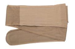 Women's nylon tights body color isokated on white Royalty Free Stock Photo