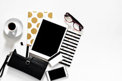 Women`s office desk on white background touch pad tablet with gold stylish books black wallet credit cards, top view. Mock up template, woman work place Stock Images