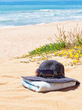 Women's Panama hat with sunglasses on a towel . Royalty Free Stock Image