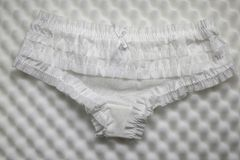 White lace panties for women. Women`s panties against sponge background stock images