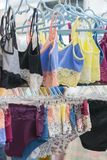 Women's panties on the hanger in the store. Lingerie in the store. New lace lingerie. vertical photo.  stock photography