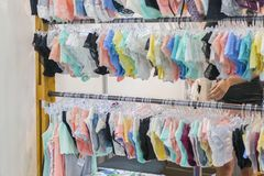 Women's panties on the hanger in the store. Lingerie in the store. New lace lingerie. Women's panties on the hanger in the store. Lingerie in the store. New stock photos