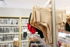 Women`s panties racked in a store. Women`s spanx underwear hangs on a rack for sale at a department store Royalty Free Stock Photos