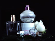 Women's perfume and cream. Stock Photography