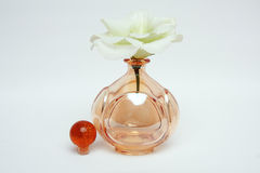 Women's perfume and delicate flower Royalty Free Stock Photos