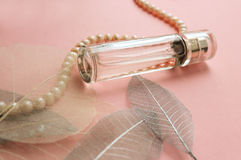 Women`s perfume in a glass vial with pearls Stock Images
