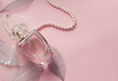 Women`s perfume in a glass vial with pearls Royalty Free Stock Image