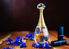 Women's perfume and lipstick Royalty Free Stock Photography