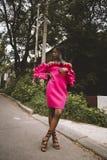 Women's Pink Long-sleeved Off-shoulder Dress stock images