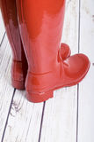 Women's Red Shiny Rubber Boots #1 Stock Image