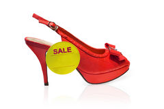 Women's red shoe with yellow label Royalty Free Stock Photos