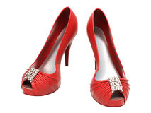 Women's red shoes. Closeup on a light background royalty free stock photography