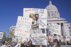 Women's rights marchers. Holding signs at State Capitol Building, Missouri Stock Image