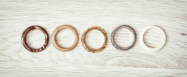 Women's rings arranged in a row on the wooden backround Stock Photo