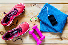 Women's running shoes and dumbbells Stock Photos
